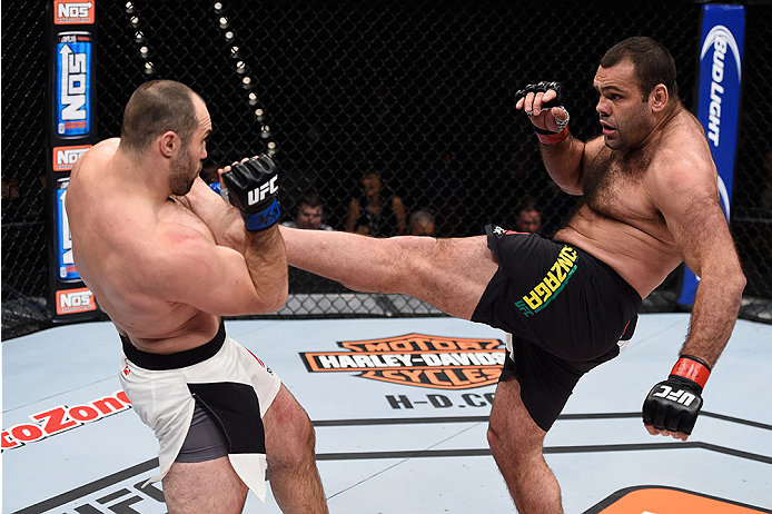 LAS VEGAS, NV - DECEMBER 11: (R-L) Gabriel Gonzaga kicks Konstantin Erokhin in their heavyweight bout during the TUF Finale event inside The Chelsea at The Cosmopolitan of Las Vegas on December 11, 2015 in Las Vegas, Nevada.  (Photo by Jeff Bottari/Zuffa