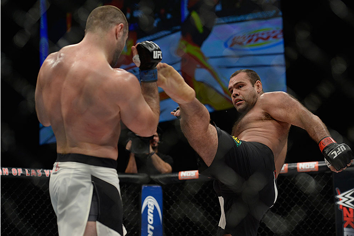 LAS VEGAS, NV - DECEMBER 11: (R-L) Gabriel Gonzaga kicks Konstantin Erokhin in their heavyweight bout during the TUF Finale event inside The Chelsea at The Cosmopolitan of Las Vegas on December 11, 2015 in Las Vegas, Nevada.  (Photo by Brandon Magnus/Zuff