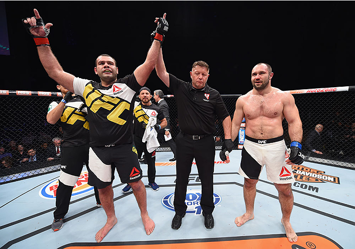 LAS VEGAS, NV - DECEMBER 11: Gabriel Gonzaga (left) is declared the winner against Konstantin Erokhin (right) in their heavyweight bout during the TUF Finale event inside The Chelsea at The Cosmopolitan of Las Vegas on December 11, 2015 in Las Vegas, Neva