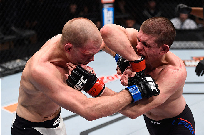 LAS VEGAS, NV - DECEMBER 11: (R-L) Joe Lauzon elbows Evan Dunham in their lightweight bout during the TUF Finale event inside The Chelsea at The Cosmopolitan of Las Vegas on December 11, 2015 in Las Vegas, Nevada.  (Photo by Jeff Bottari/Zuffa LLC/Zuffa L