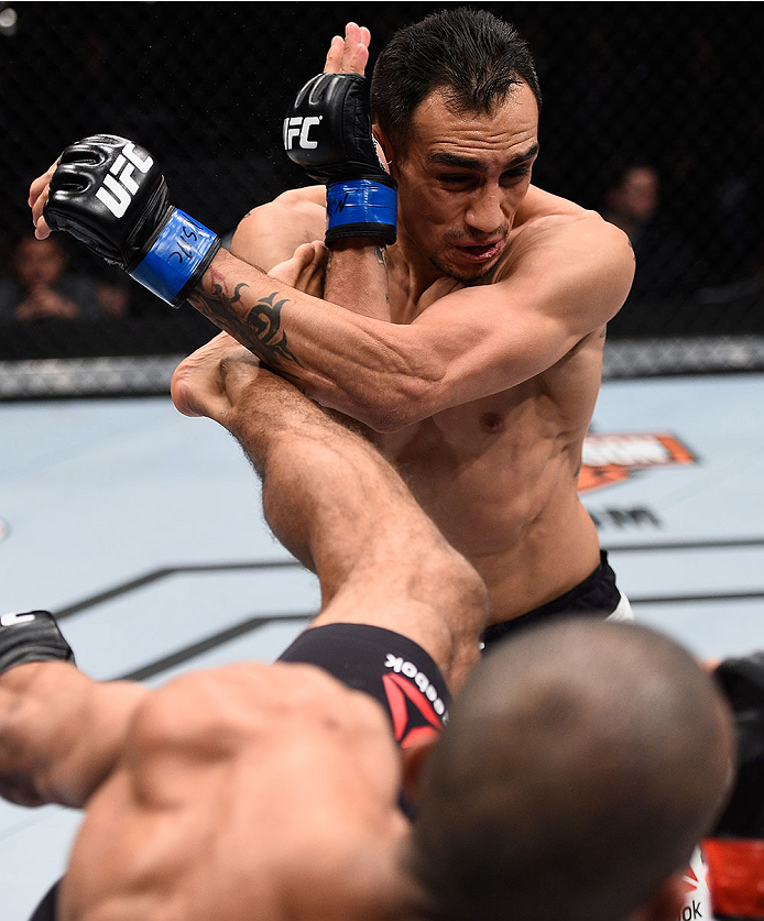 LAS VEGAS, NV - DECEMBER 11: Edson Barboza (bottom) kicks Tony Ferguson in their lightweight bout during the TUF Finale event inside The Chelsea at The Cosmopolitan of Las Vegas on December 11, 2015 in Las Vegas, Nevada.  (Photo by Jeff Bottari/Zuffa LLC/