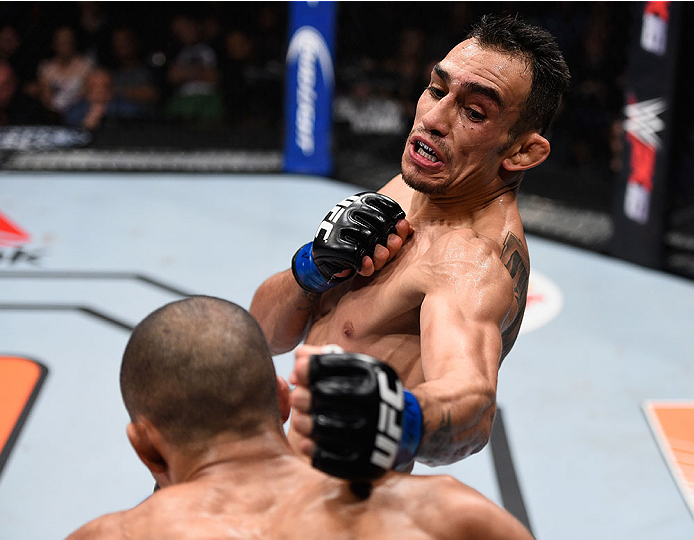LAS VEGAS, NV - DECEMBER 11: Tony Ferguson (top) punches Edson Barboza in their lightweight bout during the TUF Finale event inside The Chelsea at The Cosmopolitan of Las Vegas on December 11, 2015 in Las Vegas, Nevada.  (Photo by Jeff Bottari/Zuffa LLC/Z