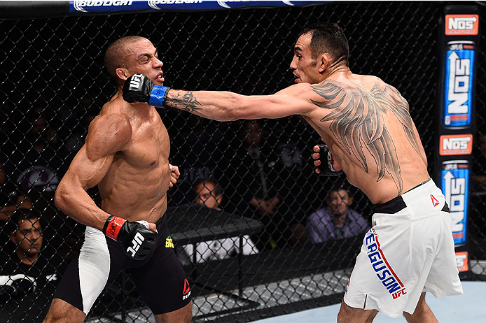 LAS VEGAS, NV - DECEMBER 11: (R-L) Tony Ferguson punches Edson Barboza in their lightweight bout during the TUF Finale event inside The Chelsea at The Cosmopolitan of Las Vegas on December 11, 2015 in Las Vegas, Nevada.  (Photo by Jeff Bottari/Zuffa LLC/Z