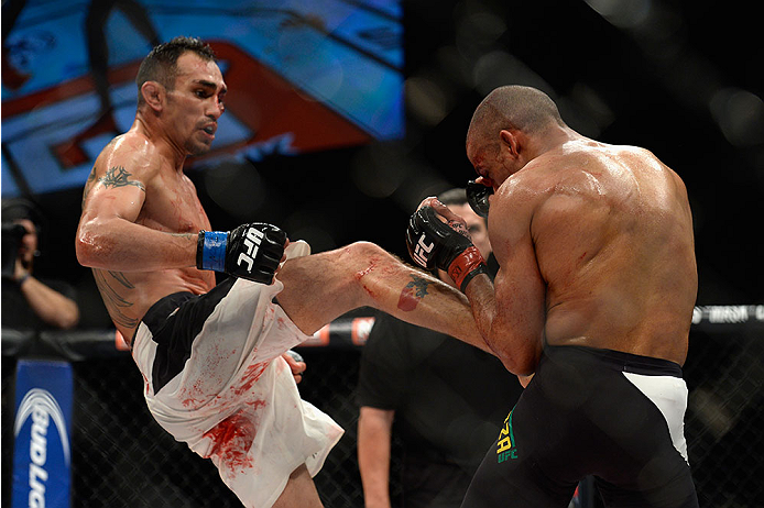 LAS VEGAS, NV - DECEMBER 11: (L-R) Tony Ferguson kicks Edson Barboza in their lightweight bout during the TUF Finale event inside The Chelsea at The Cosmopolitan of Las Vegas on December 11, 2015 in Las Vegas, Nevada.  (Photo by Brandon Magnus/Zuffa LLC/Z
