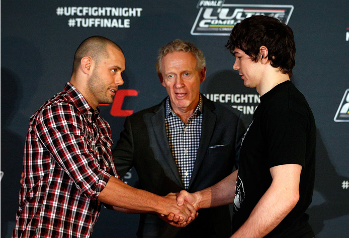 QUEBEC CITY, CANADA - APRIL 14:  (L-R) Opponents Chad Laprise and Olivier Aubin-Mercier shake hands during the UFC Ultimate Media Day at the TRYP Quebec Hotel on April 14, 2014 in Quebec City, Quebec, Canada. (Photo by Josh Hedges/Zuffa LLC/Zuffa LLC via