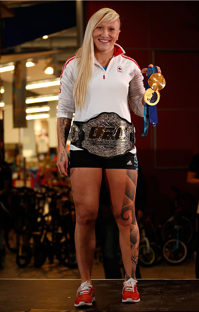 QUEBEC CITY, CANADA - APRIL 13:  Canadian Olympic gold medalist Kaillie Humphries poses with the UFC belt during the UFC open workouts at the Centre Commercial Place Fleur de Lys on April 13, 2014 in Quebec City, Quebec, Canada. (Photo by Josh Hedges/Zuff