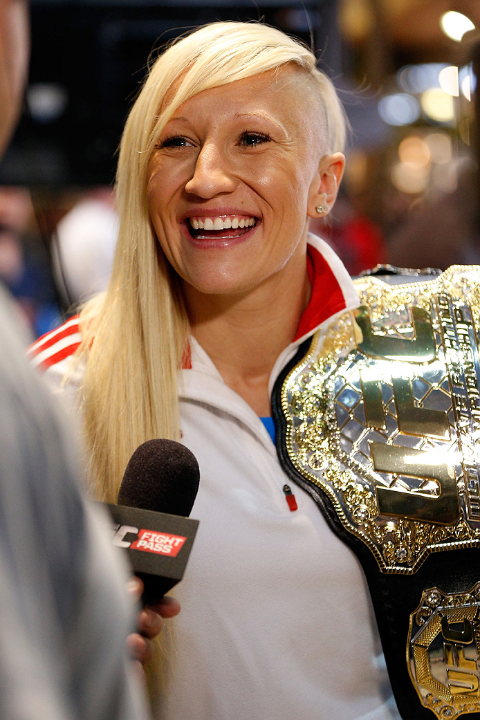 QUEBEC CITY, CANADA - APRIL 13:  Canadian Olympic gold medalist Kaillie Humphries interacts with media during the UFC open workouts at the Centre Commercial Place Fleur de Lys on April 13, 2014 in Quebec City, Quebec, Canada. (Photo by Josh Hedges/Zuffa L