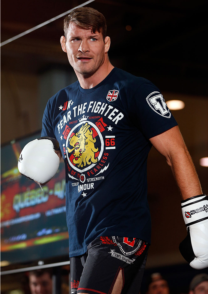 QUEBEC CITY, CANADA - APRIL 13:  Michael Bisping holds an open training session for fans and media at the Centre Commercial Place Fleur de Lys on April 13, 2014 in Quebec City, Quebec, Canada. (Photo by Josh Hedges/Zuffa LLC/Zuffa LLC via Getty Images)