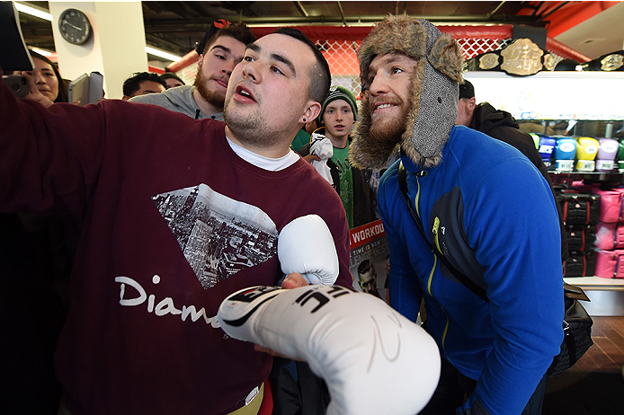 BOSTON, MA - JANUARY 15:  UFC featherweight Conor McGregor of Ireland poses with fans after an open training session at UFC Gym on January 15, 2015 in Boston, Massachusetts. (Photo by Jeff Bottari/Zuffa LLC/Zuffa LLC via Getty Images)