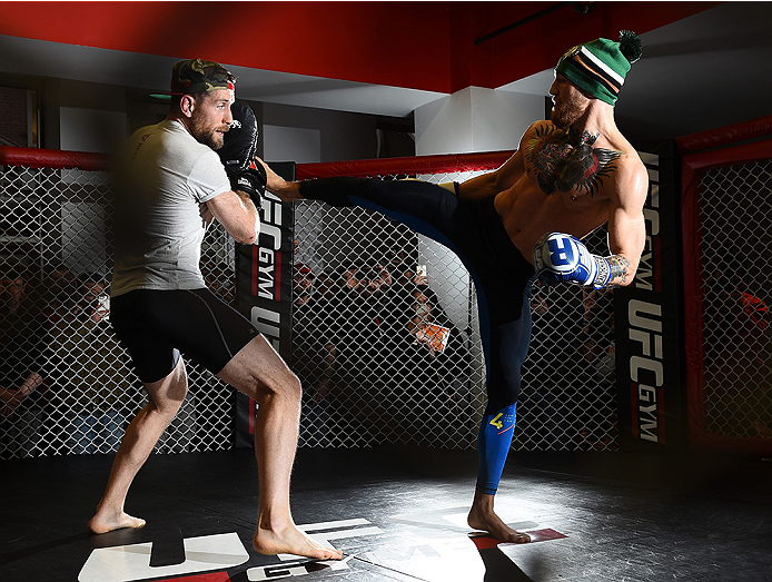 BOSTON, MA - JANUARY 15:  UFC featherweight Conor McGregor of Ireland (R) holds an open training session for the media and fans at UFC Gym on January 15, 2015 in Boston, Massachusetts. (Photo by Jeff Bottari/Zuffa LLC/Zuffa LLC via Getty Images)