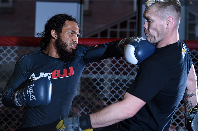 BOSTON, MA - JANUARY 15:  UFC lightweight Benson 'Smooth' Henderson (L) spars with Joe Riggs an open workout session for the media and fans at UFC Gym on January 15, 2015 in Boston, Massachusetts. (Photo by Jeff Bottari/Zuffa LLC/Zuffa LLC via Getty Image