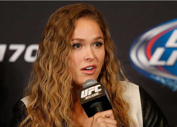 LAS VEGAS, NV - FEBRUARY 20:  Ronda Rousey interacts with media during the final UFC 170 pre-fight press conference at the Mandalay Bay Resort and Casino on February 20, 2014 in Las Vegas, Nevada. (Photo by Josh Hedges/Zuffa LLC/Zuffa LLC via Getty Images