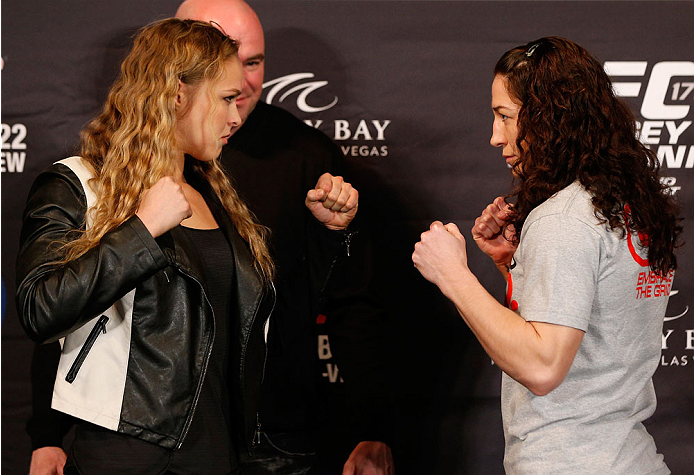 LAS VEGAS, NV - FEBRUARY 20:  (L-R) Opponents Ronda Rousey and Sara McMann face off during the final UFC 170 pre-fight press conference at the Mandalay Bay Resort and Casino on February 20, 2014 in Las Vegas, Nevada. (Photo by Josh Hedges/Zuffa LLC/Zuffa
