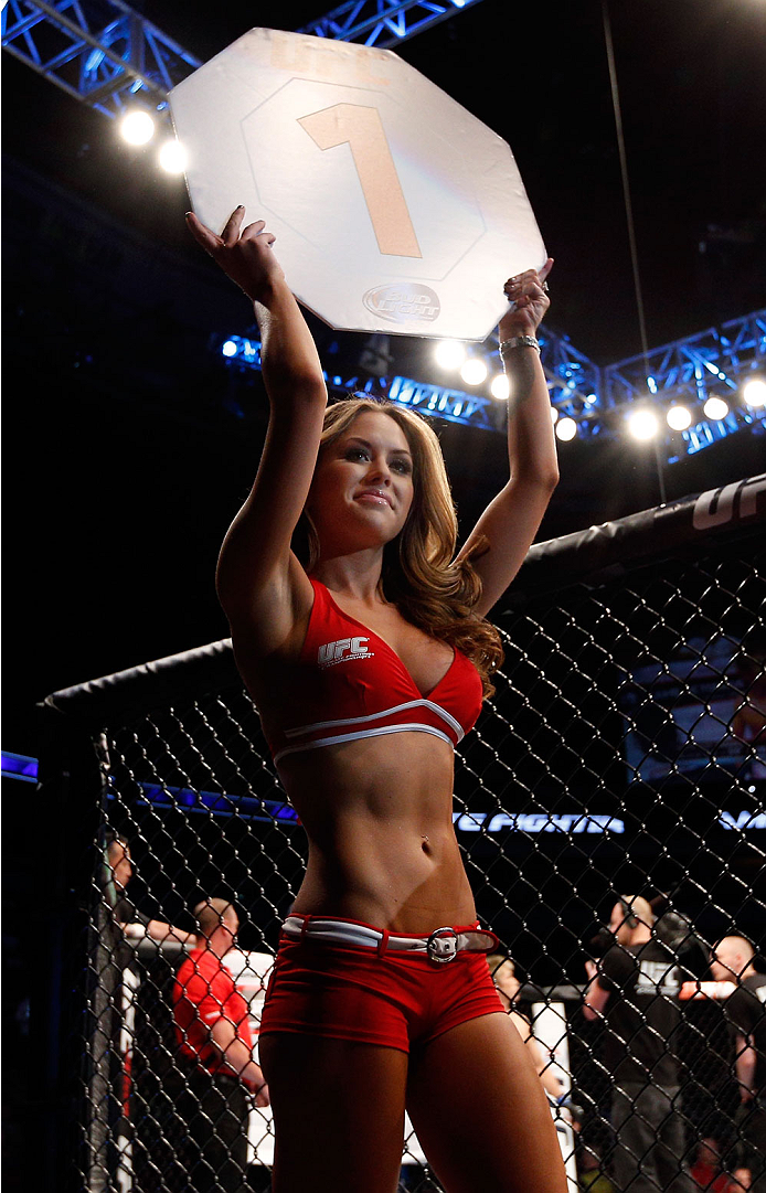 VANCOUVER, BC - JUNE 14:  UFC Octagon Girl Brittney Palmer introduces a round during the UFC 174 event at Rogers Arena on June 14, 2014 in Vancouver, Canada.  (Photo by Josh Hedges/Zuffa LLC/Zuffa LLC via Getty Images)