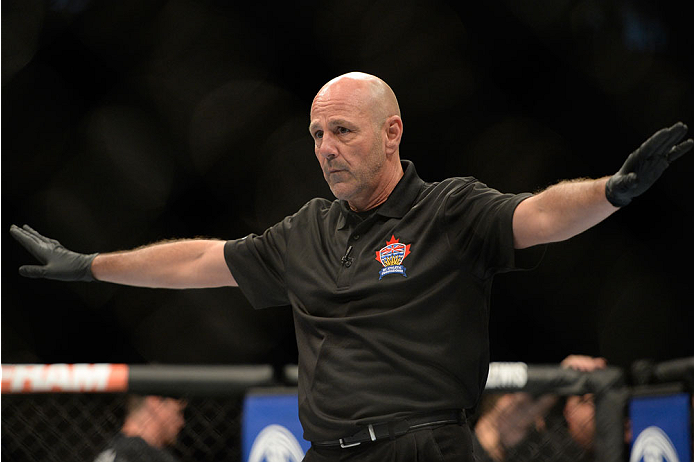 VANCOUVER, BC - JUNE 14:  Referee Yves Lavigne calls the Michinori Tanaka and Roland Delorme fight during the UFC 174 event at Rogers Arena on June 14, 2014 in Vancouver, British Columbia, Canada. (Photo by Jeff Bottari/Zuffa LLC/Zuffa LLC via Getty Image