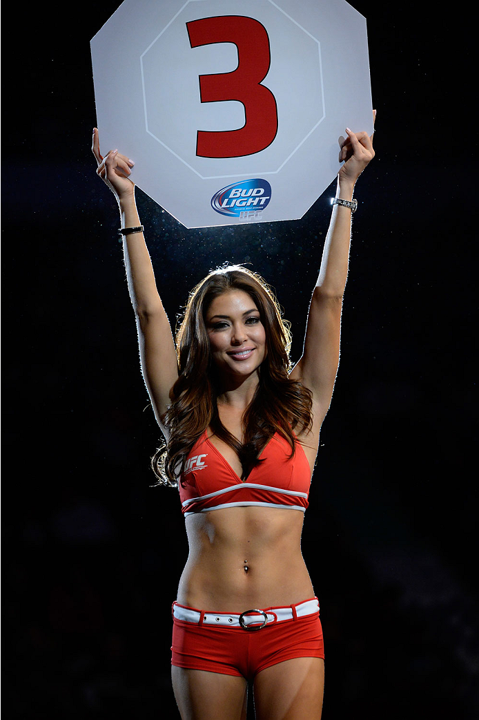 VANCOUVER, BC - JUNE 14:  UFC Octagon Girl Arianny Celeste signals the start of round three between Michinori Tanaka and Roland Delorme during the UFC 174 event at Rogers Arena on June 14, 2014 in Vancouver, British Columbia, Canada. (Photo by Jeff Bottar