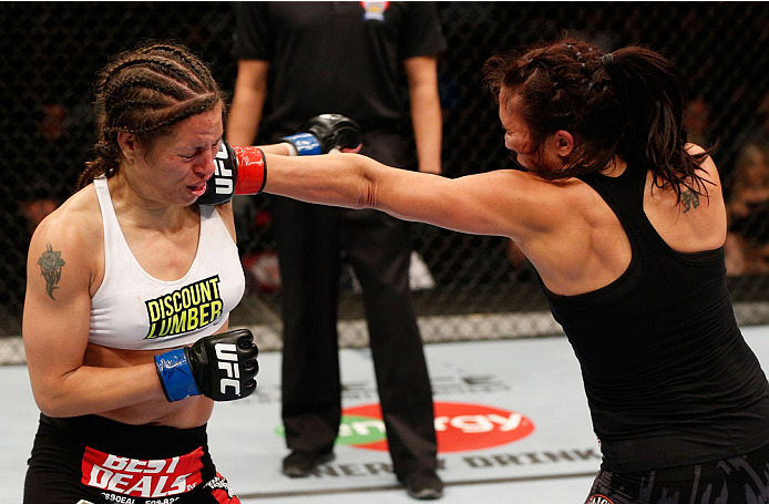 VANCOUVER, BC - JUNE 14:  (R-L) Valerie Letourneau punches Elizabeth Phillips in their womens bantamweight bout at Rogers Arena on June 14, 2014 in Vancouver, Canada.  (Photo by Josh Hedges/Zuffa LLC/Zuffa LLC via Getty Images)