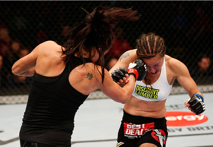 VANCOUVER, BC - JUNE 14:  (L-R) Valerie Letourneau punches Elizabeth Phillips in their womens bantamweight bout at Rogers Arena on June 14, 2014 in Vancouver, Canada.  (Photo by Josh Hedges/Zuffa LLC/Zuffa LLC via Getty Images)