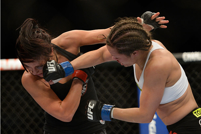 VANCOUVER, BC - JUNE 14:  (R-L) Elizabeth Phillips punches Valerie Latourneau during the UFC 174 event at Rogers Arena on June 14, 2014 in Vancouver, British Columbia, Canada. (Photo by Jeff Bottari/Zuffa LLC/Zuffa LLC via Getty Images)