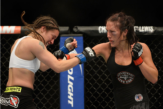 VANCOUVER, BC - JUNE 14:  (R-L) Valerie Latourneau punches Elizabeth Phillips during the UFC 174 event at Rogers Arena on June 14, 2014 in Vancouver, British Columbia, Canada. (Photo by Jeff Bottari/Zuffa LLC/Zuffa LLC via Getty Images)
