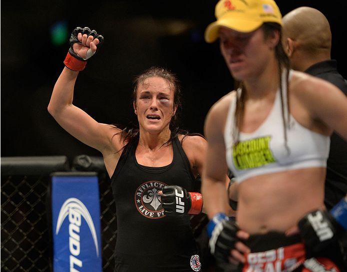 VANCOUVER, BC - JUNE 14:  (L-R) Valerie Latourneau celebrates after a split decision win over Elizabeth Phillips during the UFC 174 event at Rogers Arena on June 14, 2014 in Vancouver, British Columbia, Canada. (Photo by Jeff Bottari/Zuffa LLC/Zuffa LLC v