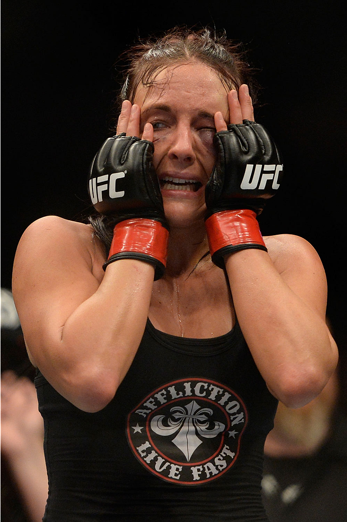 VANCOUVER, BC - JUNE 14:  Valerie Latourneau celebrates after a split decision win over Elizabeth Phillips during the UFC 174 event at Rogers Arena on June 14, 2014 in Vancouver, British Columbia, Canada. (Photo by Jeff Bottari/Zuffa LLC/Zuffa LLC via Get