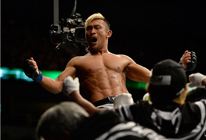 VANCOUVER, BC - JUNE 14:  Kiichi Kunimoto celebrates after defeating Daniel Sarafian by a rear naked choke during the UFC 174 event at Rogers Arena on June 14, 2014 in Vancouver, British Columbia, Canada. (Photo by Jeff Bottari/Zuffa LLC/Zuffa LLC via Get