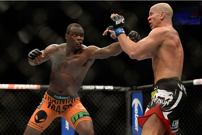 VANCOUVER, BC - JUNE 14:  (L-R) Ovince Saint Preux punches Ryan Jimmo during the UFC 174 event at Rogers Arena on June 14, 2014 in Vancouver, British Columbia, Canada. (Photo by Jeff Bottari/Zuffa LLC/Zuffa LLC via Getty Images)