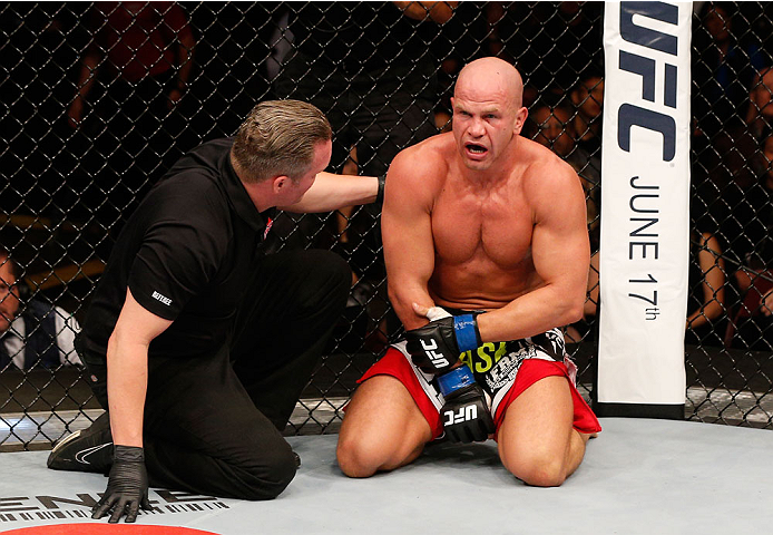VANCOUVER, BC - JUNE 14:  Ryan Jimmo clutches his arm in pain after his submission loss to Ovince Saint Preux in their light heavyweight bout at Rogers Arena on June 14, 2014 in Vancouver, Canada.  (Photo by Josh Hedges/Zuffa LLC/Zuffa LLC via Getty Image