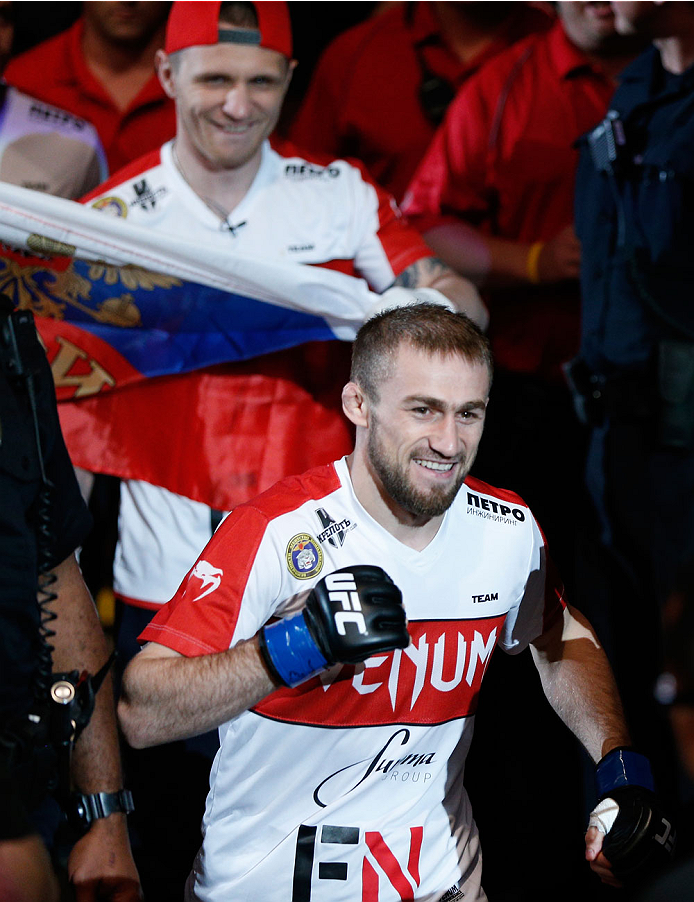 VANCOUVER, BC - JUNE 14:  Ali Bagautinov enters the arena before facing UFC Flyweight Champion Demtrious 'Mighty Mouse' Johnson in their UFC flyweight championship bout at Rogers Arena on June 14, 2014 in Vancouver, Canada.  (Photo by Josh Hedges/Zuffa LL