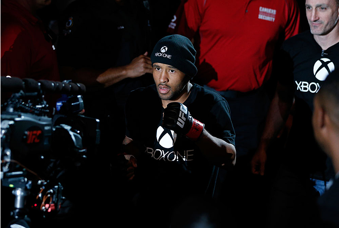 VANCOUVER, BC - JUNE 14:  UFC Flyweight Champion Demetrious 'Mighty Mouse' Johnson enters the arena before facing challenger Ali Bagautinov in their UFC flyweight championship bout at Rogers Arena on June 14, 2014 in Vancouver, Canada.  (Photo by Josh Hed
