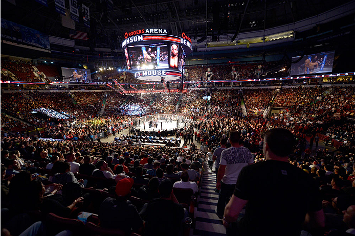 VANCOUVER, BC - JUNE 14:  A general view of Demetrious 'Mighty Mouse' Johnson entering the Octagon before his championship bout against Ali Bagautinov during the UFC 174 event at Rogers Arena on June 14, 2014 in Vancouver, British Columbia, Canada. (Photo