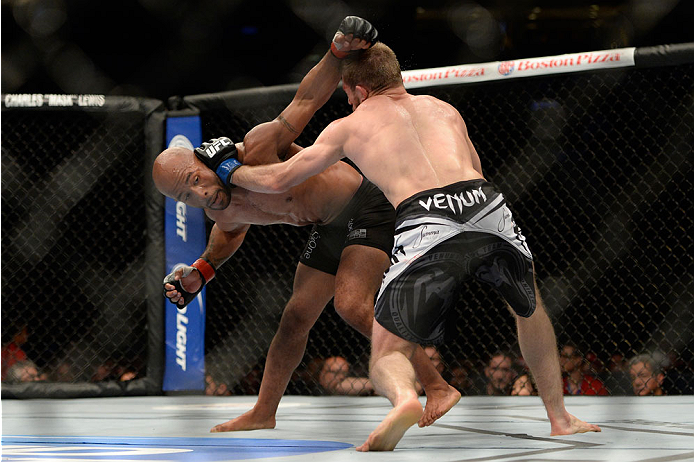 VANCOUVER, BC - JUNE 14:  (L-R) UFC Flyweight Champion Demetrious 'Mighty Mouse' Johnson punches Ali Bagautinov during their flyweight championship bout at the UFC 174 event at Rogers Arena on June 14, 2014 in Vancouver, British Columbia, Canada. (Photo b