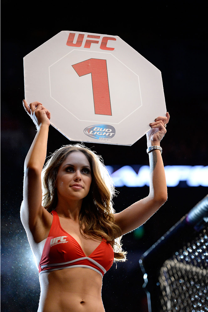 VANCOUVER, BC - JUNE 14:  UFC Octagon Girl Britney Palmer signals the start of round one between Valerie Latourneau and Elizabeth Phillips during the UFC 174 event at Rogers Arena on June 14, 2014 in Vancouver, British Columbia, Canada. (Photo by Jeff Bot