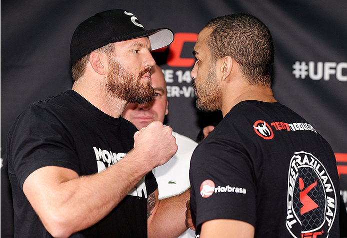"""VANCOUVER, CANADA - JUNE 12:  (L-R) Opponents Ryan Bader and Rafael """"Feijao"""" Cavalcante face off at the EA Sports Capture Lab on June 12, 2014 in Vancouver, British Columbia, Canada. (Photo by Josh Hedges/Zuffa LLC/Zuffa LLC via Getty Images)"""