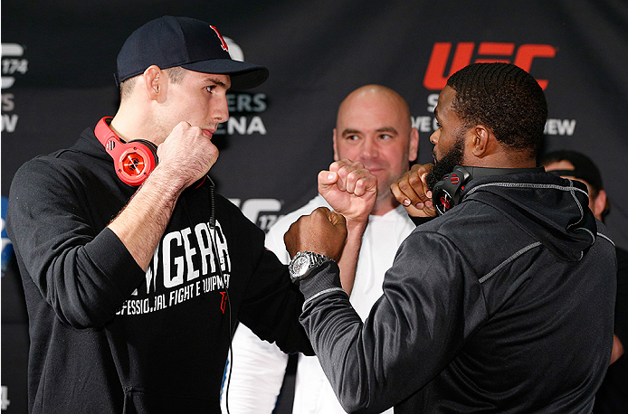 VANCOUVER, CANADA - JUNE 12:  (L-R) Opponents Rory MacDonald and Tyron Woodley face off at the EA Sports Capture Lab on June 12, 2014 in Vancouver, British Columbia, Canada. (Photo by Josh Hedges/Zuffa LLC/Zuffa LLC via Getty Images)
