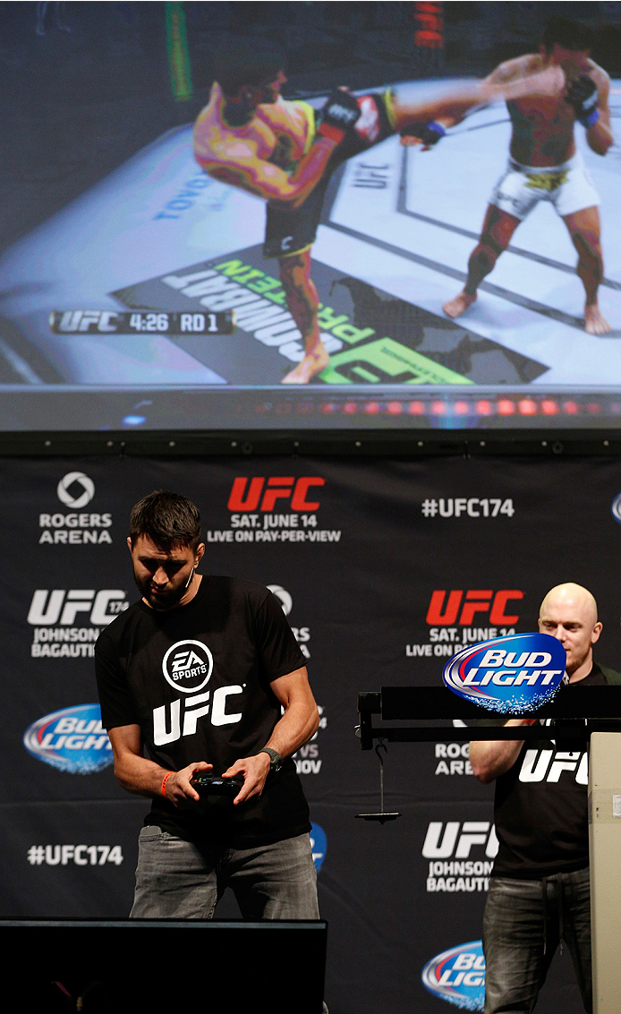 VANCOUVER, BC - JUNE 13:  Carlos Condit battles against Josh Thomson (not pictured) in a demo of the new EA Sports UFC videogame before the UFC 174 weigh-in at Rogers Arena on June 13, 2014 in Vancouver, Canada.  (Photo by Josh Hedges/Zuffa LLC/Zuffa LLC