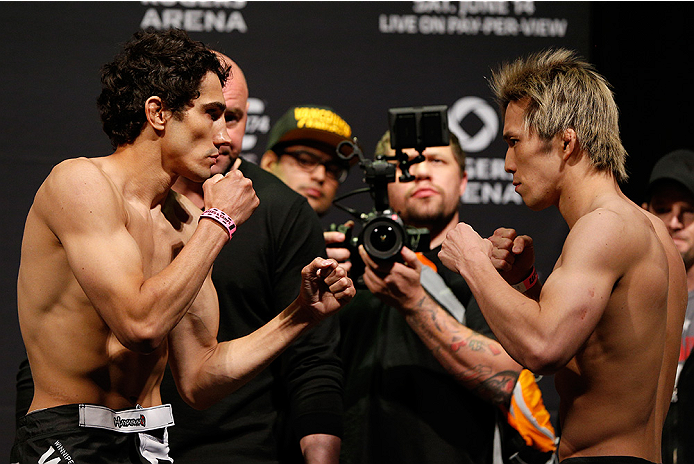 VANCOUVER, BC - JUNE 13:  (L-R) Opponents Roland Delorme and Michinori Tanaka of Japan face off during the UFC 174 weigh-in at Rogers Arena on June 13, 2014 in Vancouver, Canada.  (Photo by Josh Hedges/Zuffa LLC/Zuffa LLC via Getty Images)