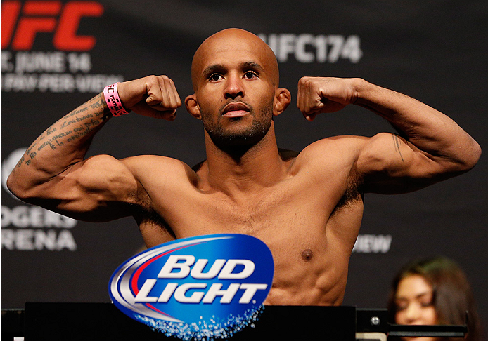"VANCOUVER, BC - JUNE 13:  UFC flyweight champion Demetrious ""Mighty Mouse"" Johnson weighs in during the UFC 174 weigh-in at Rogers Arena on June 13, 2014 in Vancouver, Canada.  (Photo by Josh Hedges/Zuffa LLC/Zuffa LLC via Getty Images)"