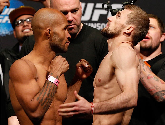 "VANCOUVER, BC - JUNE 13:  (L-R) UFC flyweight champion Demetrious ""Mighty Mouse"" Johnson and challenger Ali Bagautinov face off during the UFC 174 weigh-in at Rogers Arena on June 13, 2014 in Vancouver, Canada.  (Photo by Josh Hedges/Zuffa LLC/Zuffa LLC v"