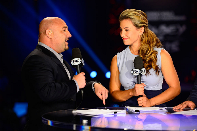 LAS VEGAS, NV - JULY 4:  Sports broadcaster Jay Glazer interacts with mixed martial artist Miesha Tate at the FOX television desk during the UFC 175 weigh-in inside the Mandalay Bay Events Center on July 4, 2014 in Las Vegas, Nevada. (Photo by Jeff Bottar