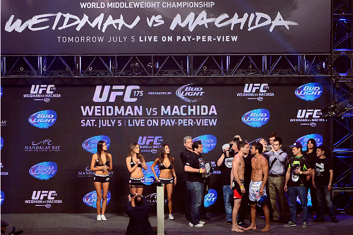 LAS VEGAS, NV - JULY 4:  UFC Middleweight Champion Chris Weidman (L) and challenger Lyoto Machida face off during the UFC 175 weigh-in inside the Mandalay Bay Events Center on July 4, 2014 in Las Vegas, Nevada. (Photo by Jeff Bottari/Zuffa LLC/Zuffa LLC v