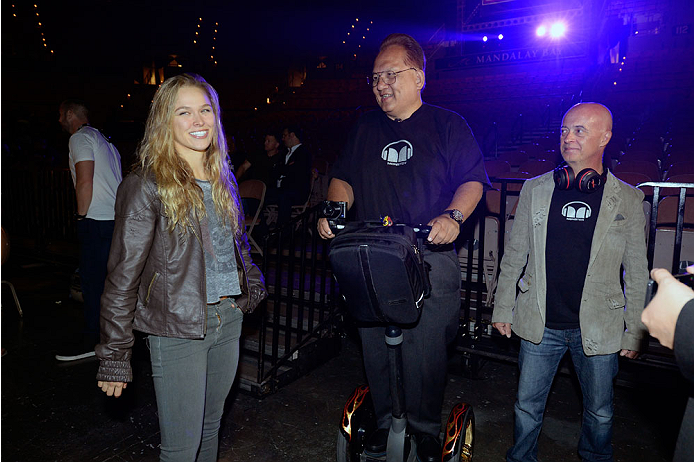 LAS VEGAS, NV - JULY 4:  UFC Women's Bantamweight Champion Ronda Rousey (L) interacts with CEO OF Monster Noel Lee (C) during the UFC 175 weigh-in inside the Mandalay Bay Events Center on July 4, 2014 in Las Vegas, Nevada. (Photo by Jeff Bottari/Zuffa LLC
