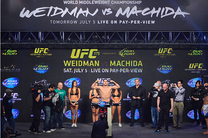 LAS VEGAS, NV - JULY 4:  UFC Middleweight Champion Chris Weidman steps on the scale during the UFC 175 weigh-in inside the Mandalay Bay Events Center on July 4, 2014 in Las Vegas, Nevada. (Photo by Jeff Bottari/Zuffa LLC/Zuffa LLC via Getty Images)