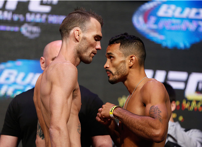 LAS VEGAS, NV - JULY 04:  (L-R) George Roop faces off with Rob Font during the UFC 175 weigh-in inside the Mandalay Bay Events Center on July 4, 2014 in Las Vegas, Nevada.  (Photo by Josh Hedges/Zuffa LLC/Zuffa LLC via Getty Images)