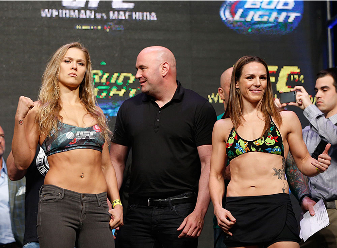 LAS VEGAS, NV - JULY 04:  (L-R) UFC Women's Bantamweight Champion Ronda Rousey faces off with Alexis Davis during the UFC 175 weigh-in inside the Mandalay Bay Events Center on July 4, 2014 in Las Vegas, Nevada.  (Photo by Josh Hedges/Zuffa LLC/Zuffa LLC v