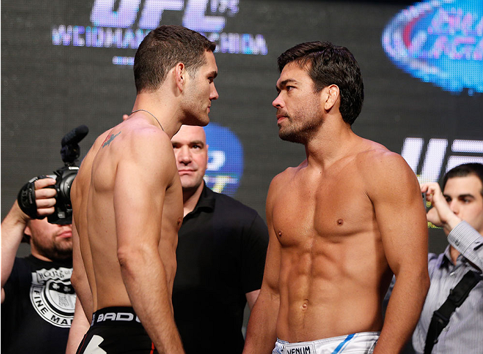 LAS VEGAS, NV - JULY 04:  (L-R) UFC Middleweight Champion Chris Weidman faces off with Lyoto Machida during the UFC 175 weigh-in inside the Mandalay Bay Events Center on July 4, 2014 in Las Vegas, Nevada.  (Photo by Josh Hedges/Zuffa LLC/Zuffa LLC via Get