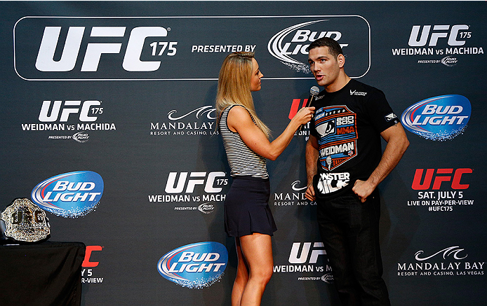 LAS VEGAS, NV - JULY 02:  (R-L) UFC middleweight champion Chris Weidman is interviewed by Carolyn Pearce before an open training session ahead of UFC 175 at the Fashion Show Mall on July 2, 2014 in Las Vegas, Nevada.  (Photo by Josh Hedges/Zuffa LLC/Zuffa