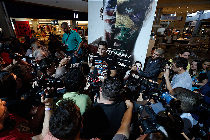 LAS VEGAS, NV - JULY 02:  UFC middleweight champion Chris Weidman interacts with media after an open training session ahead of UFC 175 at the Fashion Show Mall on July 2, 2014 in Las Vegas, Nevada.  (Photo by Josh Hedges/Zuffa LLC/Zuffa LLC via Getty Imag