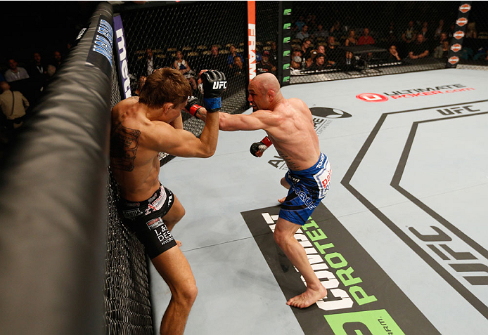 LAS VEGAS, NV - SEPTEMBER 27:  Manval Gamburyan punches Cody Gibson in their bantamweight fight during the UFC 178 event inside the MGM Grand Garden Arena on September 27, 2014 in Las Vegas, Nevada.  (Photo by Josh Hedges/Zuffa LLC/Zuffa LLC via Getty Ima